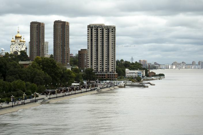 Buildings stand near the Amur River in Khabarovsk, Russia, a city in the country's Far East, Sunday, Sept. 12, 2021. The results of parliamentary and local elections that wrap up on Sunday, Sept. 19, 2021, will be closely watched to gauge how much anger against the Kremlin remains in the region, where its popular governor was arrested last year, causing mass protests. (AP Photo/Daniel Kozin)