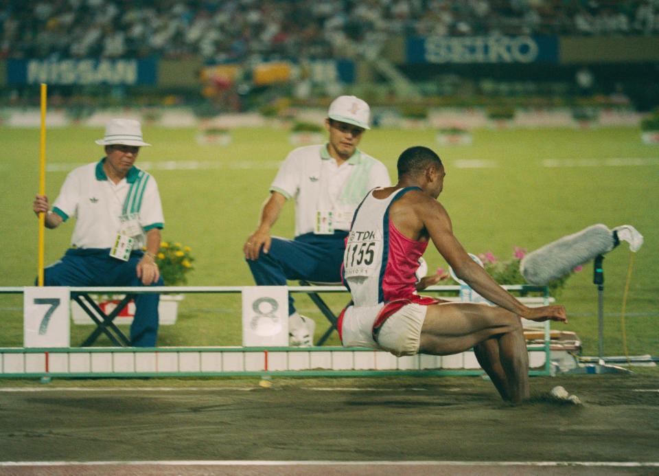 Mike Powell of the United State making his world record leap during the Long Jump event at the IAAF World Athletic Championships on 30th August 1991 at the Olympic Stadium in Tokyo, Japan. Powell broke Bob Beamon's 23-year-old long jump world record by 5 cm (2 inches), leaping 8.95 m (29 ft 4 in). (Photo by Bob Martin/Getty Images)