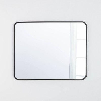 """<p><strong>Threshold x Studio McGee</strong></p><p>target.com</p><p><strong>$70.00</strong></p><p><a href=""""https://www.target.com/p/24-x-36-rectangular-decorative-mirror-with-rounded-corners-threshold-designed-with-studio-mcgee/-/A-81078369"""" rel=""""nofollow noopener"""" target=""""_blank"""" data-ylk=""""slk:BUY NOW"""" class=""""link rapid-noclick-resp"""">BUY NOW</a></p><p>Whether you style it horizontally or vertically, this mirror looks great in virtually any room in your home, including your bathroom, entryway, or on top of a dresser in your bedroom. </p>"""