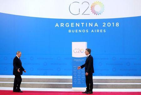 Russia's President Vladimir Putin is welcomed by Argentina's President Mauricio Macri as he arrives for the G20 leaders summit in Buenos Aires, Argentina November 30, 2018. REUTERS/Marcos Brindicci