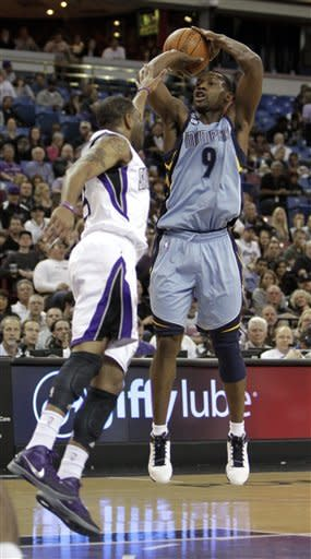 Memphis Grizzlies guard Tony Allen, right, shoots over Sacramento Kings guard Marcus Thornton during the first quarter of an NBA basketball game in Sacramento, Calif., Tuesday, March 20, 2012. (AP Photo/Rich Pedroncelli)