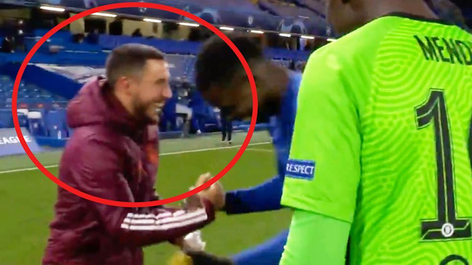 Eden Hazard (pictured left) sharing a handshake and a laugh with Chelsea players.