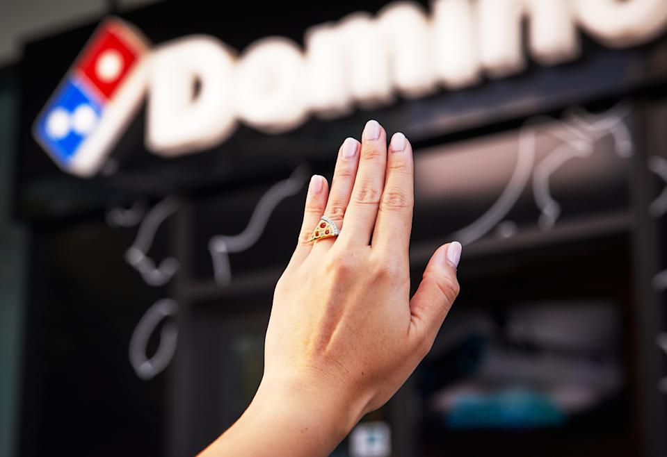 A female hand wearing Domino's Australia's pizza engagement ring