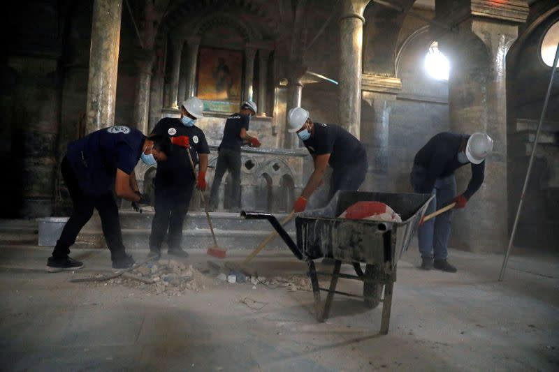 Young Iraqis help clean up historic Mosul church