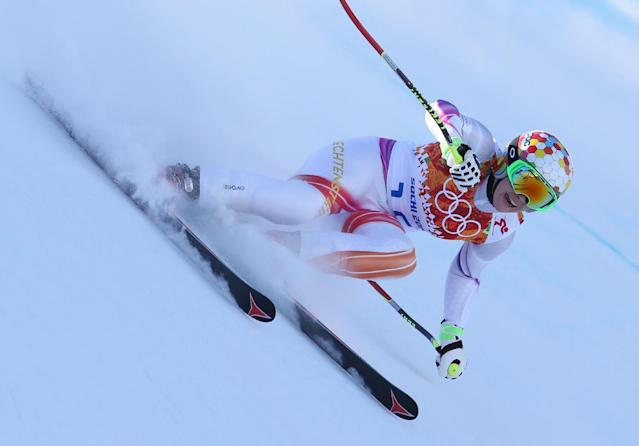 Liechtenstein's Tina Weirather makes a turn in a women's downhill training run for the Sochi 2014 Winter Olympics, Friday, Feb. 7, 2014, in Krasnaya Polyana, Russia. (AP Photo/Alessandro Trovati)