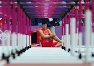 LONDON, ENGLAND - AUGUST 07: Xiang Liu of China sits on the track after getting injured in the Men's 110m Hurdles Round 1 Heats on Day 11 of the London 2012 Olympic Games at Olympic Stadium on August 7, 2012 in London, England. (Photo by Stu Forster/Getty Images)