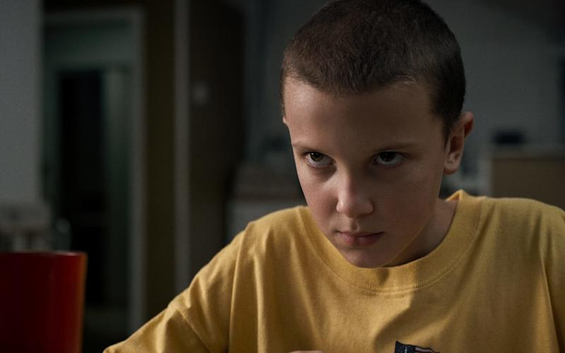 Millie Bobby Brown as Eleven in Netflix's sci-fi hit Stranger Things - Netlix