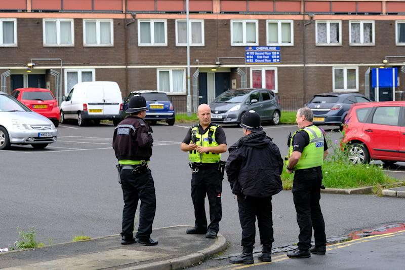 Police officers in discussion at the scene on Monday evening. (SWNS)