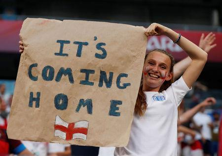 England fan celebrates after the match. REUTERS/Lee Smith