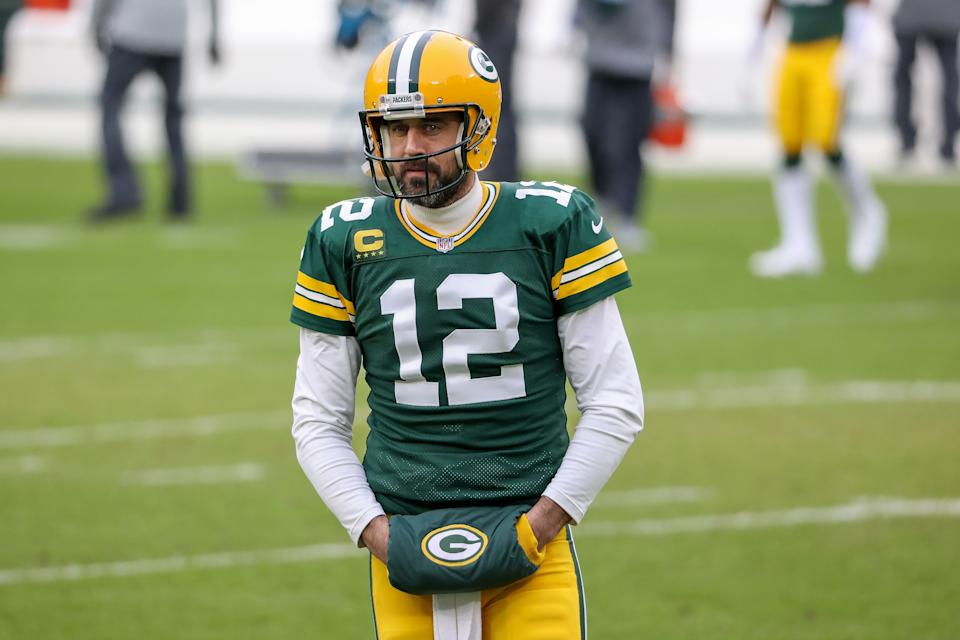 GREEN BAY, WISCONSIN - JANUARY 24: Aaron Rodgers #12 of the Green Bay Packers warms up before the NFC Championship game against the Tampa Bay Buccaneers at Lambeau Field on January 24, 2021 in Green Bay, Wisconsin. (Photo by Dylan Buell/Getty Images)