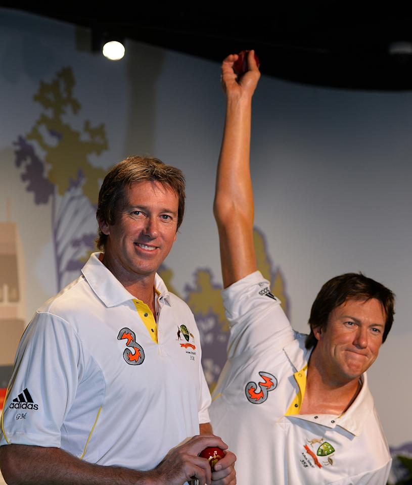 Australia's cricket legent Glenn McGrath (L) poses for photos during the launch of his wax figure at Madame Tussauds in Sydney on July 31, 2013. McGrath was the winner of the Madame Tussauds Sydney Aussie votes campaign where the Australian public was asked to cast their votes on which Australian sporting hero they wanted to see immortalised in wax.     AFP PHOTO / Saeed Khan        (Photo credit should read SAEED KHAN/AFP/Getty Images)