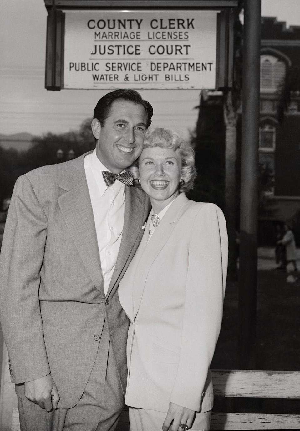 <p>Doris Day and Marty Melcher opted for matching ensembles on their wedding day. Wearing a cream-colored menswear-inspired suit, the <em>Pillow Talk </em>actress made it official with the film producer at Burbank City Hall.</p>