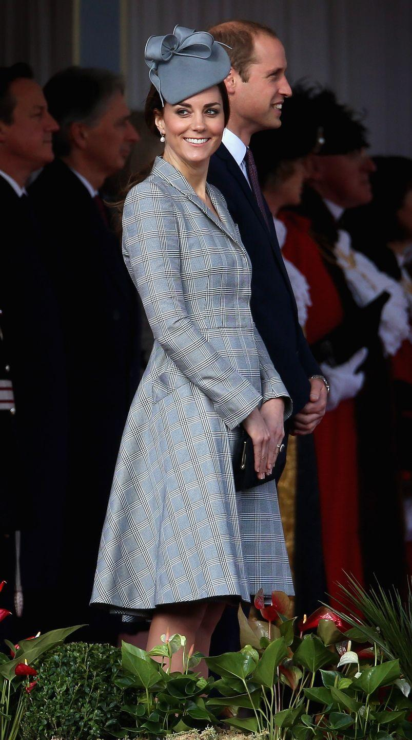 <p>In 2014, Kate Middleton had to share the news she was expecting again early into her pregnancy due to her acute morning sickness. In her first appearance after the announcement, she wore a stunning Alexander McQueen coat dress from the designer's pre-spring/summer 2015 collection. </p>