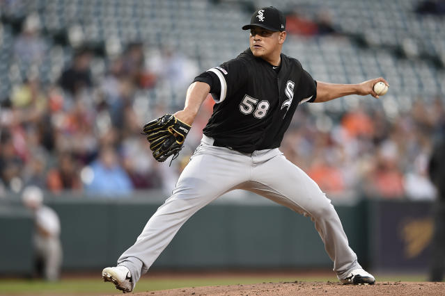 Chicago White Sox pitcher Manny Banuelos delivers against the Baltimore Orioles in the first inning of a baseball game, Monday, April 22, 2019, in Baltimore. (AP Photo/Gail Burton)