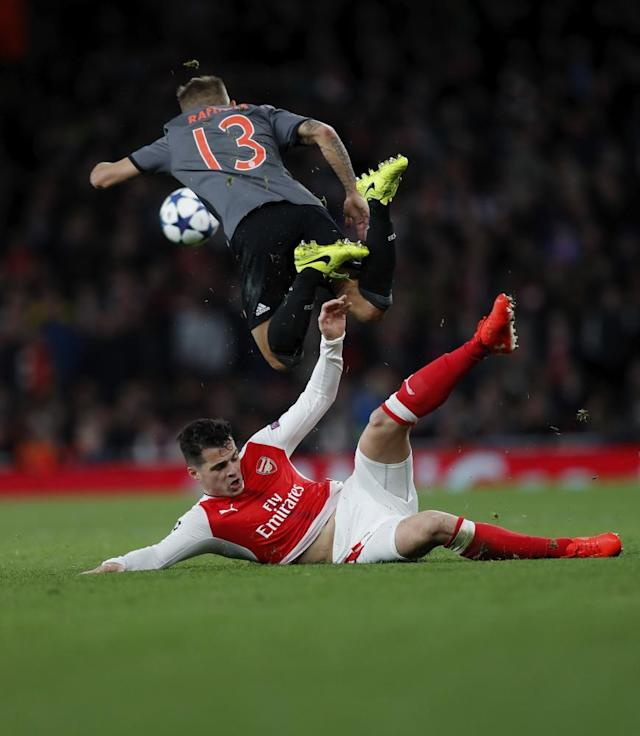 """<span class=""""element-image__caption"""">Granit Xhaka earns himself a yellow card for an awkward lunge on Rafinha.</span> <span class=""""element-image__credit"""">Photograph: Boris Streubel/Getty Images</span>"""