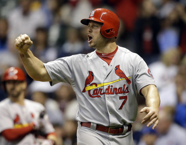 St. Louis Cardinals' Matt Holliday reacts after scoring on David Freese' two-run single against the Milwaukee Brewers during the eighth inning of a baseball game Saturday, Sept. 21, 2013, in Milwaukee. (AP Photo/Jeffrey Phelps)