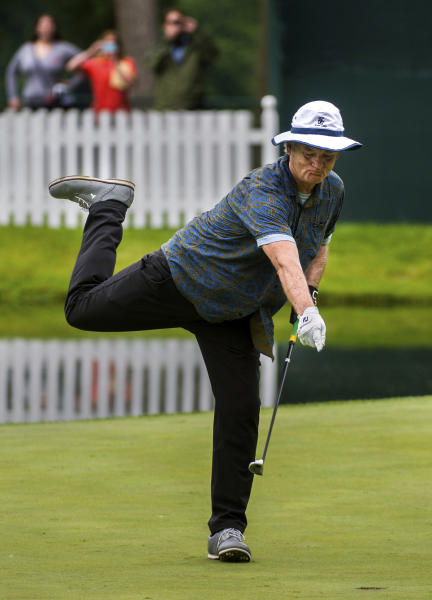 """FILE - In this July 8, 2015, file photo, actor Bill Murray celebrates as he drops his final putt drops in on the 18th during the John Deere Classic Pro-Am, in Silvis, Ill. """"Caddyshack"""" starring Murray was No. 4 in The Associated Press' Top 25 favorite sports movies poll. (Fred Zwicky/Journal Star via AP)"""