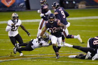 Chicago Bears running back David Montgomery (32) breaks away from New Orleans Saints outside linebacker Demario Davis (56) in the first half of an NFL football game in Chicago, Sunday, Nov. 1, 2020. (AP Photo/Nam Y. Huh)
