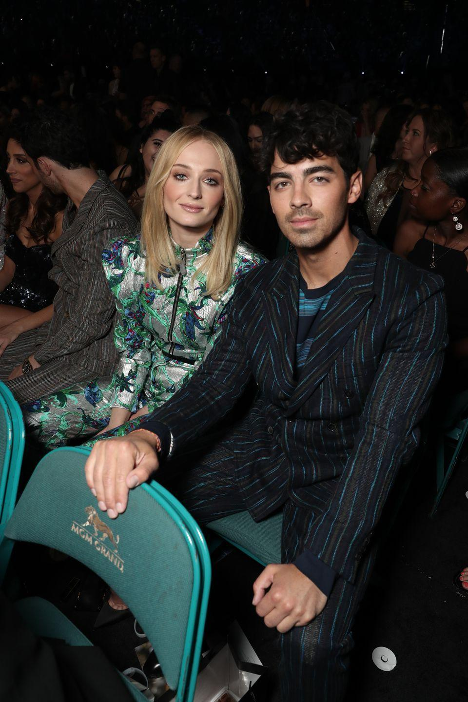 """<p>Details about Sophie Turner and Joe Jonas's summer wedding in France were already spreading when they <a href=""""https://www.harpersbazaar.com/celebrity/latest/a27339851/sophie-turner-joe-jonas-wedding-las-vegas-photos/"""" rel=""""nofollow noopener"""" target=""""_blank"""" data-ylk=""""slk:eloped in Las Vegas"""" class=""""link rapid-noclick-resp"""">eloped in Las Vegas</a> following the 2019 Billboard Music Awards. Apparently, the couple had to legally wed in the U.S. before their international vows and decided to have a secret Vegas ceremony — but <a href=""""https://twitter.com/MyeishaEssex/status/1123810778119905280?ref_src=twsrc%5Etfw%7Ctwcamp%5Etweetembed%7Ctwterm%5E1123810778119905280%7Ctwgr%5Eshare_3&ref_url=https%3A%2F%2Fwww.harpersbazaar.com%2Fcelebrity%2Flatest%2Fa27339851%2Fsophie-turner-joe-jonas-wedding-las-vegas-photos%2F"""" rel=""""nofollow noopener"""" target=""""_blank"""" data-ylk=""""slk:Diplo blew up their plan"""" class=""""link rapid-noclick-resp"""">Diplo blew up their plan</a> by live streaming their wedding on Instagram. </p>"""