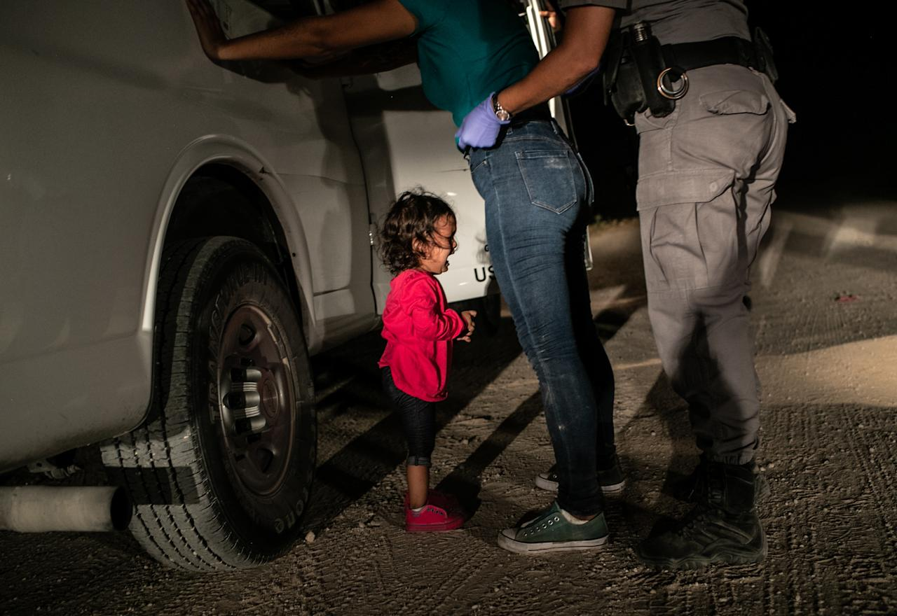 <p>Honduran toddler Yanela Sanchez cries as she and her mother, Sandra Sanchez, are taken into custody by US border officials in McAllen, Texas, USA, on 12 June, 2018. (John Moore/Getty) </p>