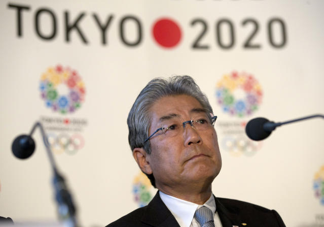 "FILE - This is a Thursday, Jan. 10, 2013 file photo of Tsunekazu Takeda, President of the Tokyo 2020 Olympic games bid, as he listens to a question from the media during their first international presentation of the Tokyo 2020 Olympic Games bid in London. France's financial crimes office says International Olympic Committee member Takeda is being investigated for corruption related to the 2020 Tokyo Olympics. The National Financial Prosecutors office says Takeda, the president of the Japanese Olympic Committee, was placed under formal investigation for ""active corruption"" on Dec. 10.(AP Photo/Alastair Grant, File)"