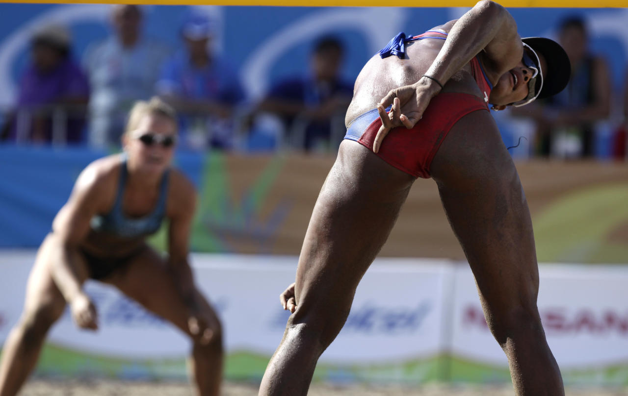 Puerto Rico's Yarleen Santiango, right, gestures during a women's beach volleyball match against Argentina at the Pan American Games in Puerto Vallarta, Mexico, Tuesday Oct. 18, 2011. (AP Photo/Ariana Cubillos)