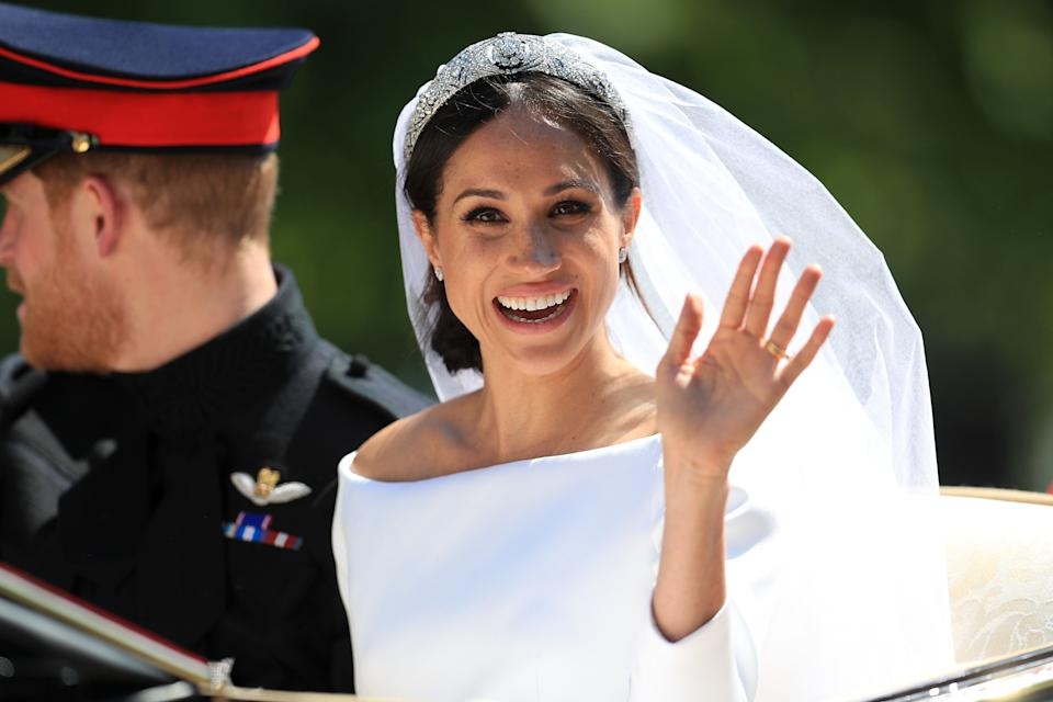 Meghan Markle waves to the crowd.