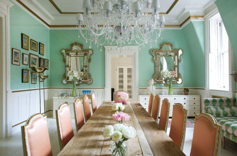 <p>The walls in this spacious dining room are washed in a lively pairing of mint green and white. Gold borders finish the look. </p>