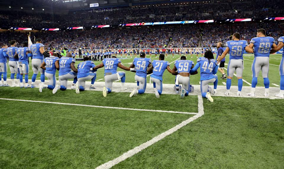 Members of the Detroit Lions take a knee during the playing of the national anthem prior to the start of the game against the Atlanta Falcons at Ford Field on September 24, 2017 in Detroit, Michigan. (Photo by Rey Del Rio/Getty Images)