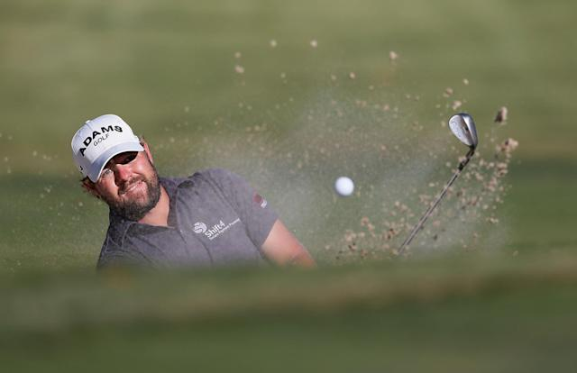 ATLANTA, GA - SEPTEMBER 23: Ryan Moore hits a bunker shot on the 16th hole during the final round of the TOUR Championship by Coca-Cola at East Lake Golf Club on September 23, 2012 in Atlanta, Georgia. (Photo by Kevin C. Cox/Getty Images)