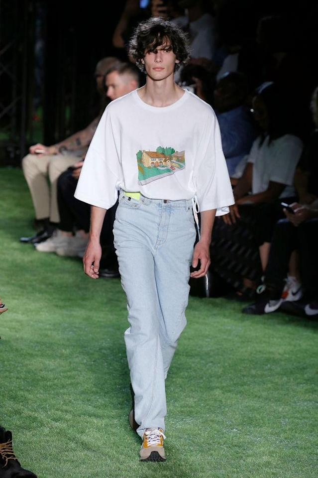 <p>Model wears white T-shirt with <em>The Simpsons</em> house with lightwashed jeans at the Spring 2019 Off-White men's show in Paris. (Photo: Getty Images) </p>