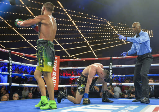 Vasiliy Lomachenko heads to a neutral corner after a second knockdown of Jose Pedraza in the 11th round of the WBO title lightweight boxing match at Madison Square Garden, Saturday, Dec. 8, 2018, in New York. (AP Photo/Howard Simmons)