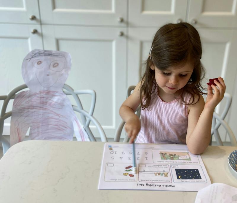 """""""Never without her grandma"""": This image by Melanie Lowis of London shows 5-year-old Millie, who made a cutout of her beloved 73-year-old grandmother, a retired teacher, to partner with her on home schooling. """"When lockdown ends, and the real grandma can return, it will be a very happy and emotional reunion,"""" Lowis wrote."""