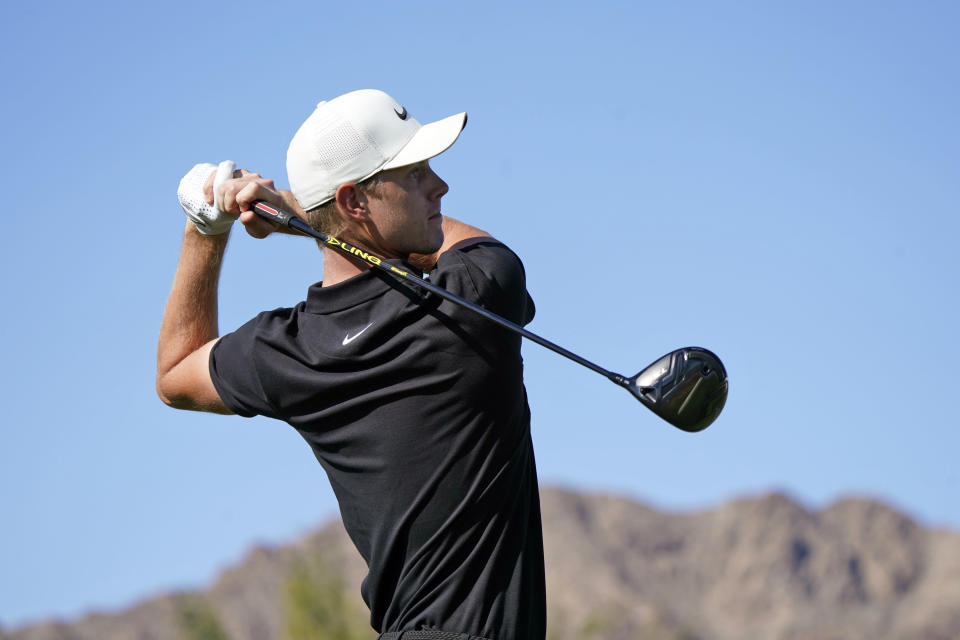 Cameron Davis hits from the first tee during the final round of The American Express golf tournament on the Pete Dye Stadium Course at PGA West Sunday, Jan. 24, 2021, in La Quinta, Calif. (AP Photo/Marcio Jose Sanchez)