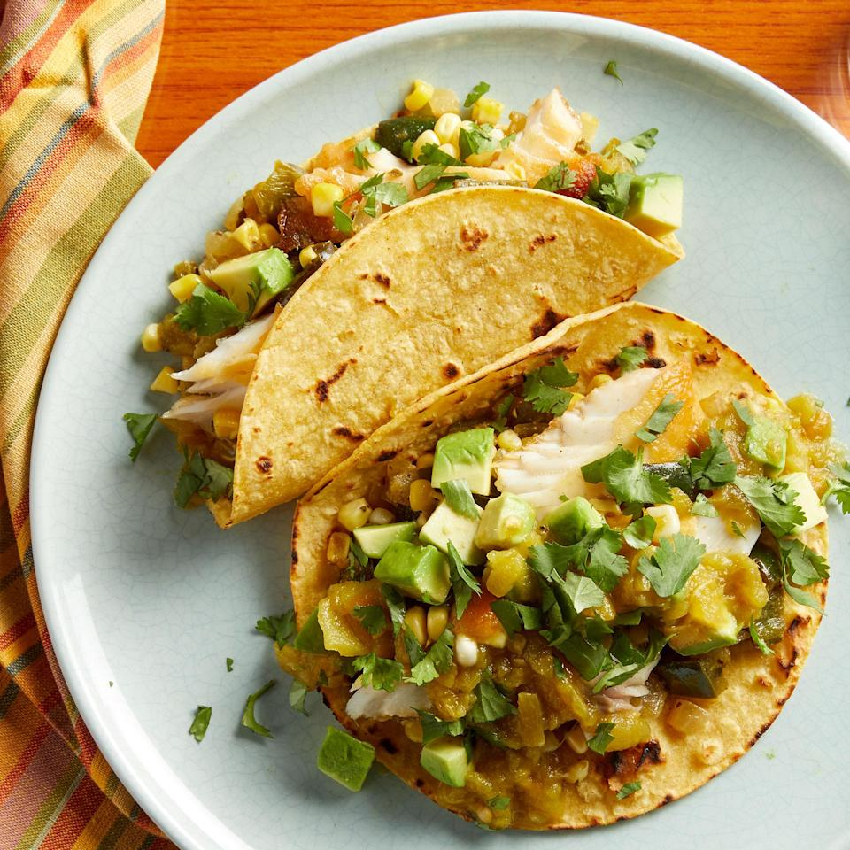 <p>Here's a quick take on fish tacos: just sauté fish, onions and peppers and serve with tortillas and some simple toppings. Poblano peppers vary immensely in heat level and tasting them is the only way to judge how hot they are. So before cooking, taste your poblanos and add a pinch of cayenne or a jalapeño if you want more heat. Use green bell peppers if you want a milder taco.</p>