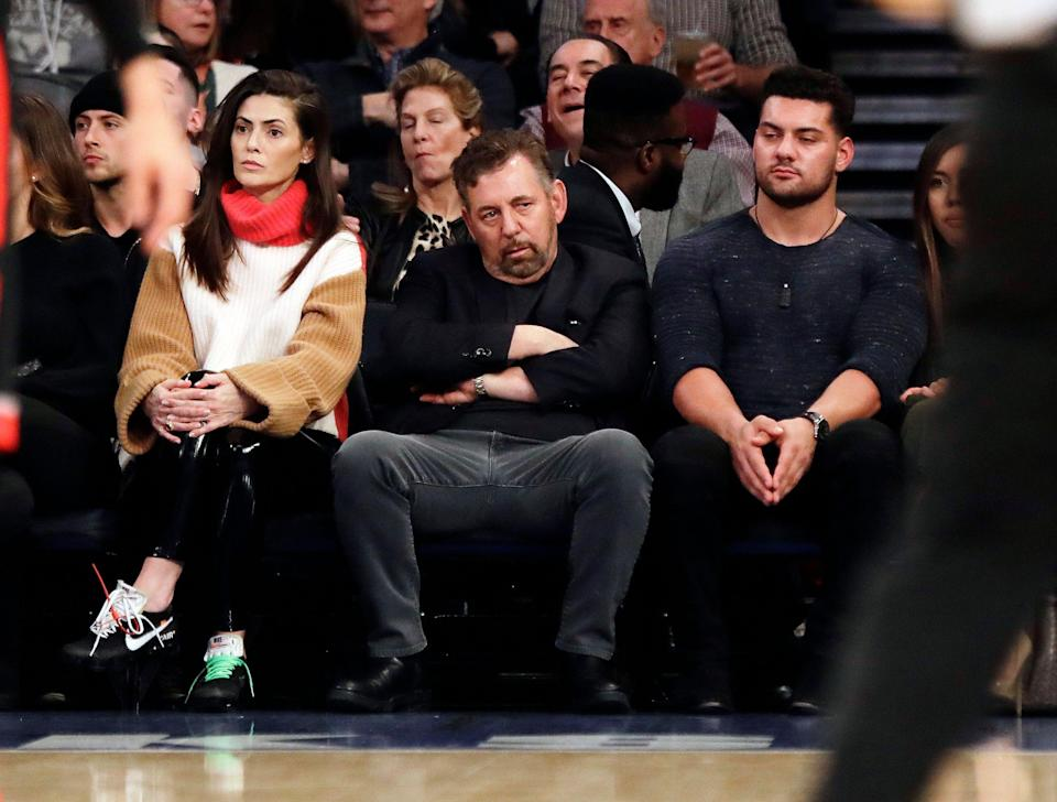 Madison Square Garden chairman James Dolan, center, watches during the first half of an NBA basketball game between the New York Knicks and the Toronto Raptors, Saturday, Feb. 9, 2019, in New York. (AP Photo/Frank Franklin II)