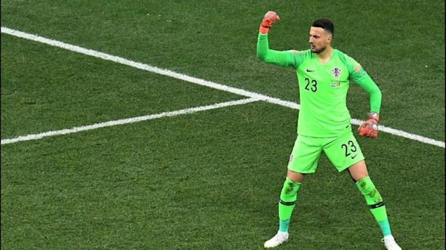 Goalkeeper Danijel Subasic shines as Croatia squeezes into the World Cup quarter-finals after a penalty shootout victory over Denmark.