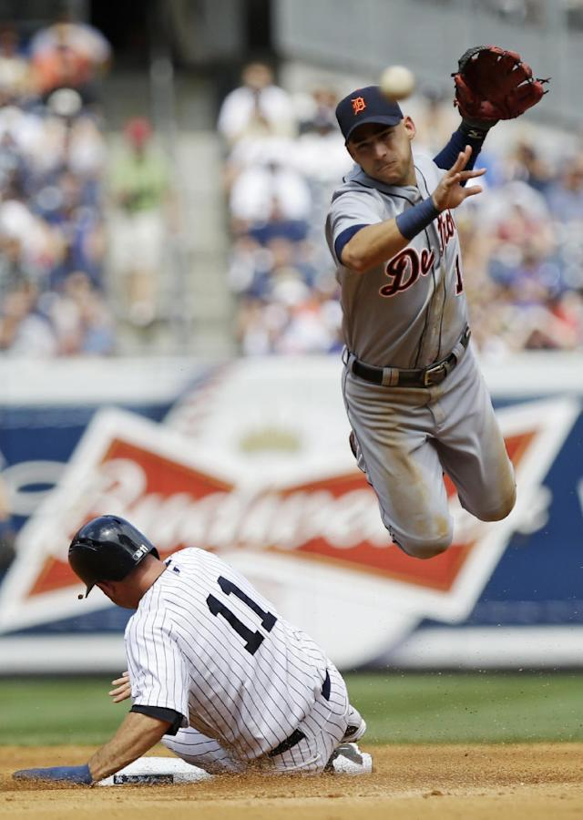 Detroit Tigers Jose Iglesias (1) throws to first base after forcing out New York Yankees' Brett Gardner (11) during the fourth inning of a baseball game Saturday, Aug. 10, 2013, in New York. (AP Photo/Frank Franklin II)