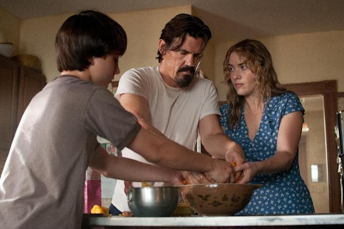 """This image released by Paramount Pictures shows Gattlin Griffith, left, Josh Brolin and Kate Winslet in a scene from """"Labor Day."""" (AP Photo/Paramount Pictures, Dale Robinette)"""