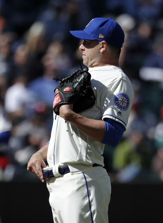 Seattle Mariners relief pitcher Anthony Swarzak stretches as he waits for the next batter after giving up a three-run home run to Texas Rangers' Logan Forsythe in the eighth inning of a baseball game Sunday, April 28, 2019, in Seattle. (AP Photo/Elaine Thompson)