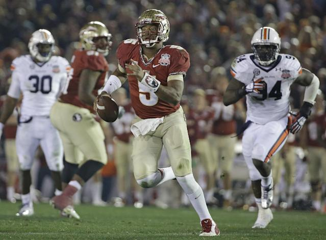 Florida State's Jameis Winston scrambles during the second half of the NCAA BCS National Championship college football game against Auburn Monday, Jan. 6, 2014, in Pasadena, Calif. (AP Photo/David J. Phillip)