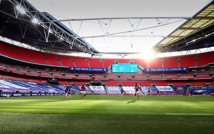 A general view of an empty Wembley Stadium as Reece James of Chelsea takes on Pierre-Emerick Aubameyang of Arsenal during the FA Cup Final match between Arsenal and Chelsea at Wembley Stadium on August 1, 2020 in London, England - Marc Atkins/Getty Images Europe