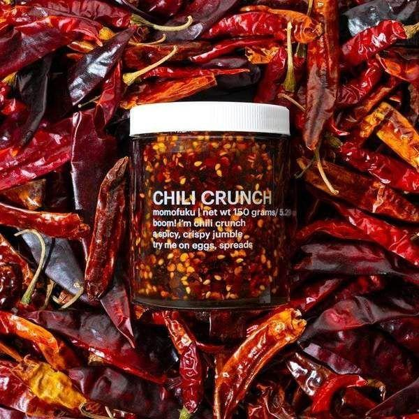 """<p><strong>Momofuku</strong></p><p>Momofuku</p><p><strong>$12.00</strong></p><p><a href=""""https://shop.momofuku.com/products/chili-crunch"""" rel=""""nofollow noopener"""" target=""""_blank"""" data-ylk=""""slk:Shop Now"""" class=""""link rapid-noclick-resp"""">Shop Now</a></p><p>We have loved a lot of the products from David Chang's team at Momofuku and this crunch is no different. The crisp to oil ratio slides heavily to the crisp side and we definitely aren't complaining. </p>"""
