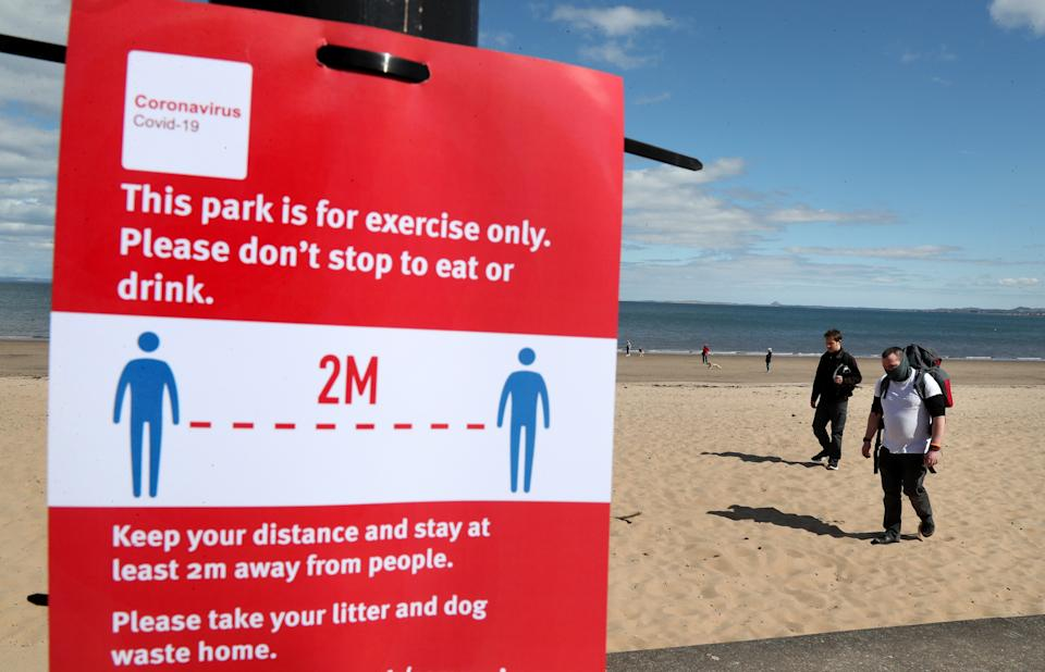 Members of the public walk along the beach front at Portobello as the UK continues in lockdown to help curb the spread of the coronavirus. (Photo by Andrew Milligan/PA Images via Getty Images)