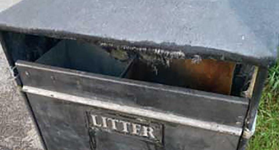 A garbage bin is pictured.