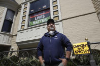"""FILE - In this June 14, 2020, file photo, James Juanillo poses outside of his home in San Francisco. Fed up with white people calling 911 about people of color selling water bottles, barbecuing or otherwise going about with life, San Francisco Board of Supervisors will vote Tuesday, Oct. 20, 2020, on the Caution Against Racial and Exploitative Non-Emergencies Act, also known as the CAREN legislation, a nod to a widespread meme using the name """"Karen"""" to describe a specific type of white, middle-aged woman, who exhibits behaviors that stem from privilege such as using the police to target people of color. (AP Photo/Jeff Chiu, File)"""