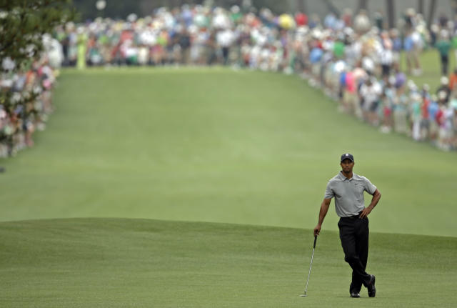 <p>Tiger Woods waits to hit off the first fairway during the first round of the Masters golf tournament Thursday, April 11, 2013, in Augusta, Ga. (AP Photo/Matt Slocum) </p>