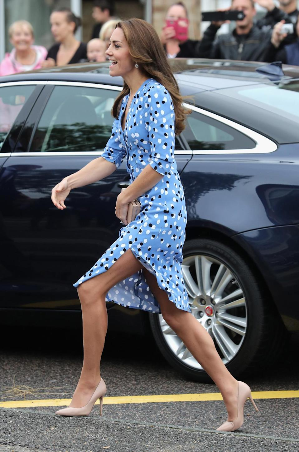 <p>For another mental health engagement, the Duchess opted for a colourful vibe in a polka-dot Altuzarra dress featuring a risqué thigh-high split. </p><p><i>[Photo: Getty] </i><br></p>
