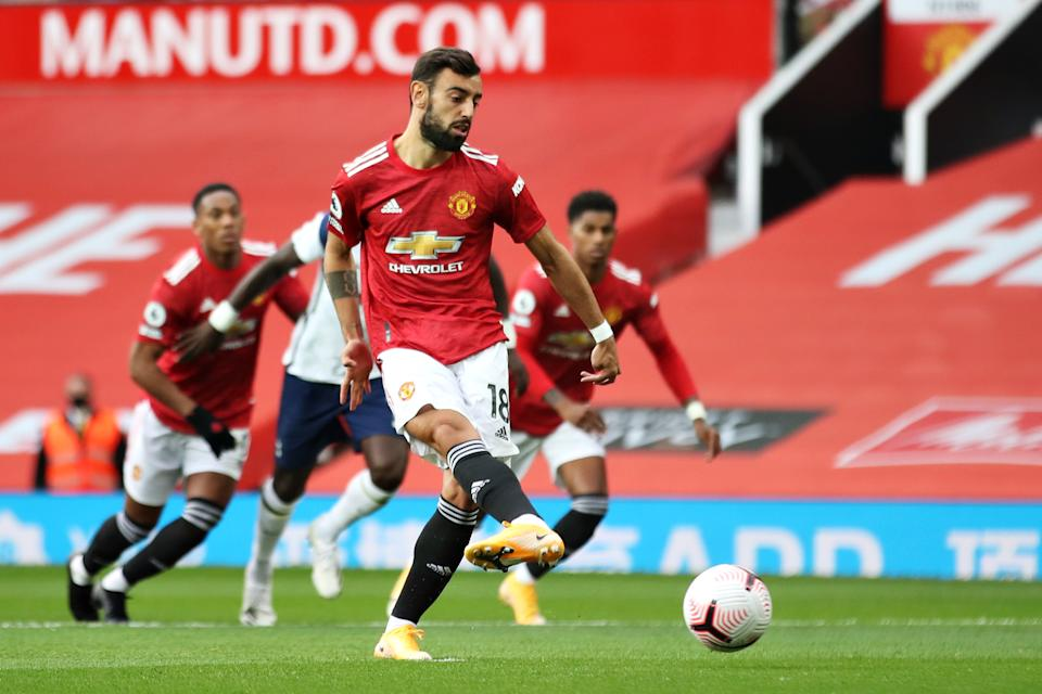 MANCHESTER, ENGLAND - OCTOBER 04: Bruno Fernandes of Manchester United scores his sides first goal from the penalty spot during the Premier League match between Manchester United and Tottenham Hotspur at Old Trafford on October 04, 2020 in Manchester, England. Sporting stadiums around the UK remain under strict restrictions due to the Coronavirus Pandemic as Government social distancing laws prohibit fans inside venues resulting in games being played behind closed doors. (Photo by Carl Recine - Pool/Getty Images)