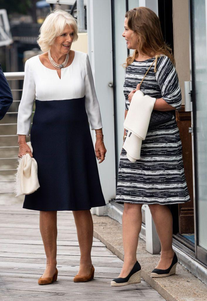<p>The Duchess of Cornwall wore a sleek navy blue and white color-blocked dress while visiting the Maiden yacht in London with Princess Haya Bint Al Hussein and Prince Charles. </p>